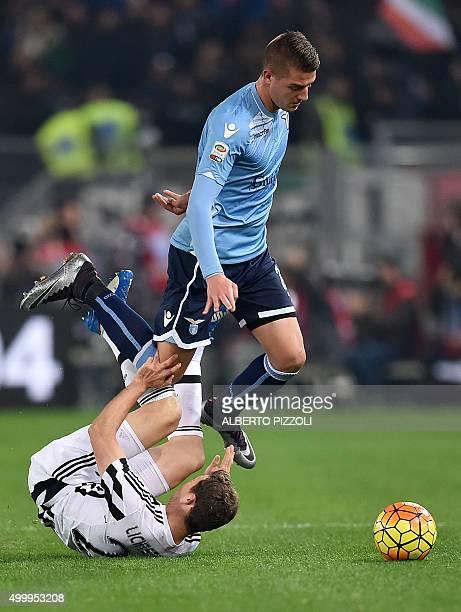 Juventus' defender from Switzerland Stephan Lichtsteiner vies for the ball with Lazio's midfielder from Serbia Sergej MilinkovicSavic during the...