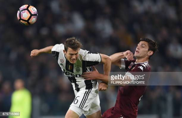 Juventus defender from Switzerland Stephan Lichtsteiner vies with Torino's forward form Argentina Lucas Boye during the Italian Serie A football...