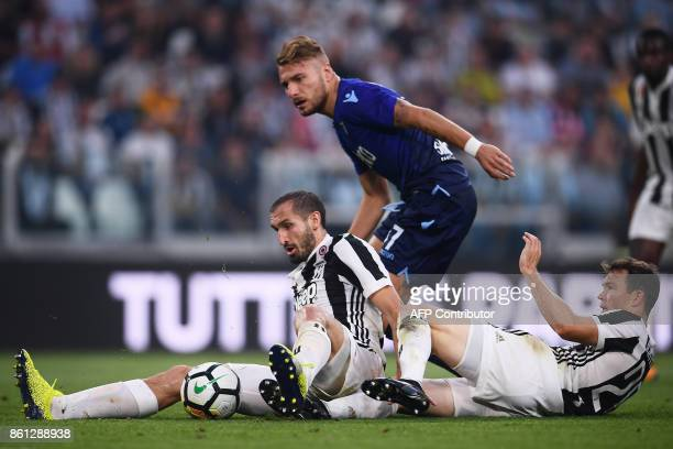 Juventus' defender Giorgio Chiellini and Juventus' defender Stephan Lichtsteiner from Switzerland fight for the ball with Lazio's forward Ciro...