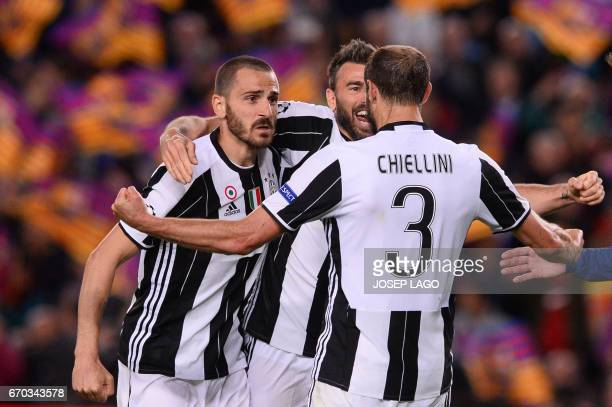 Juventus' defender Giorgio Chiellini celebrates their qualification with teammates at the end of the UEFA Champions League quarterfinal second leg...