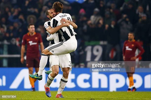 Juventus' defender Giorgio Chiellini celebrates with Juventus' defender Daniele Rugani at the end of the Italian Serie A football match Juventus vs...