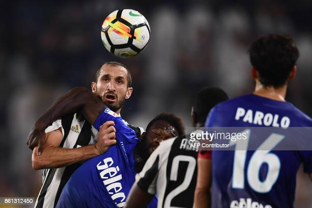 Juventus' defender Giorgio Chiellini fights for the ball with Lazio's defender Bartolomeu Quissanga Bastos of Angola during the Italian Serie A...