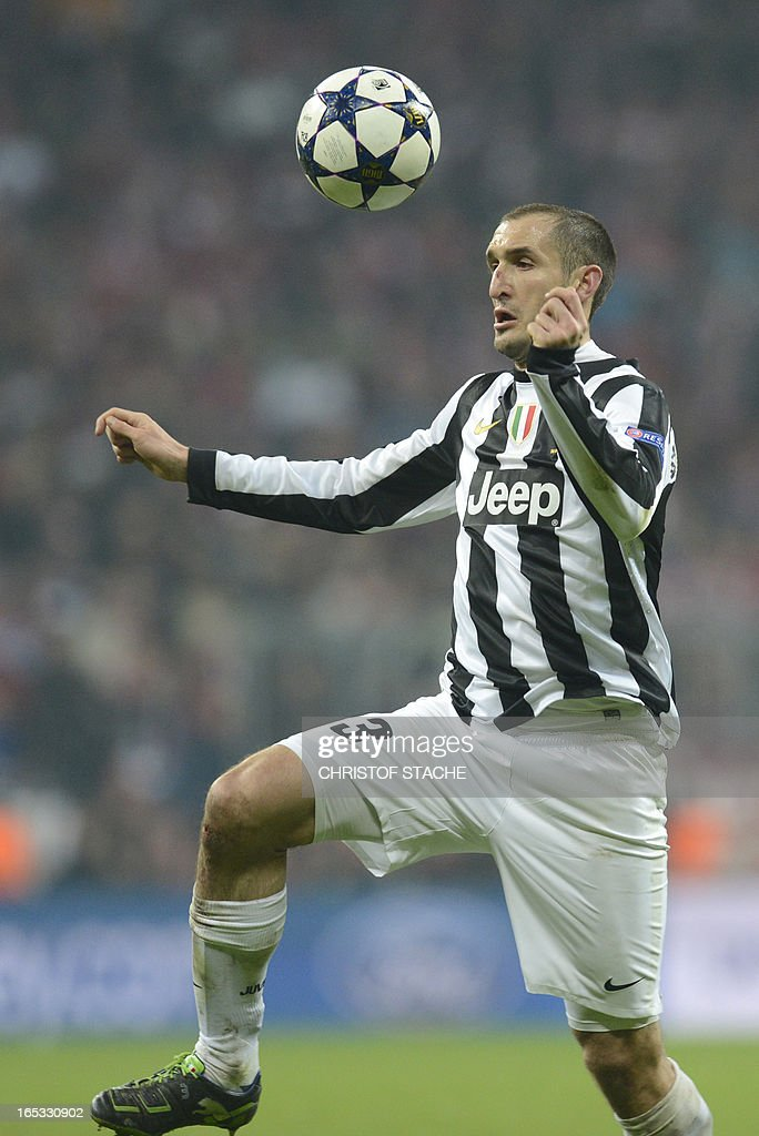 Juventus' defender Giorgio Chiellini plays the ball during the UEFA Champions League quarter final football match FC Bayern Munich vs Juventus Turin in Munich, southern Germany, on April 2, 2013.