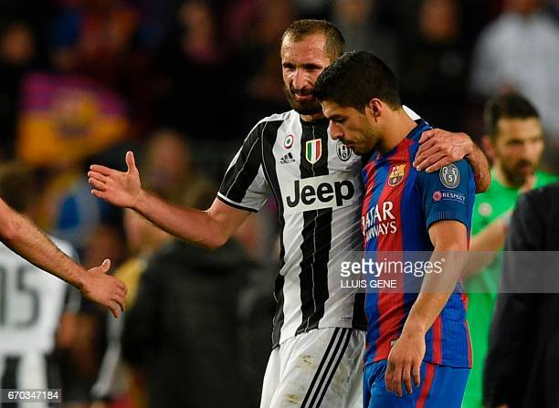 Juventu's defender Giorgio Chiellini talks with Barcelona's Uruguayan forward Luis Suarez after the UEFA Champions League quarterfinal second leg...