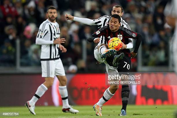 Juventus' defender Giorgio Chiellini vies with AC Milan's Colombian forward Carlos Bacca during the Italian Serie A football match between Juventus...