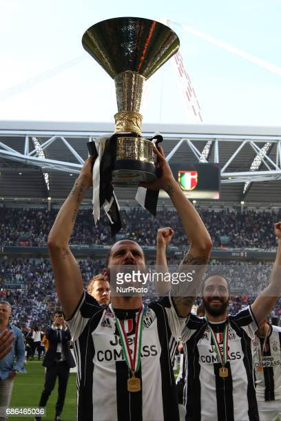 Juventus defender Leonardo Bonucci celebrates victory holding Serie A cup after the Serie A football match n37 JUVENTUS CROTONE on at the Juventus...