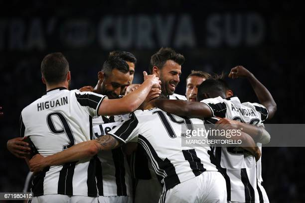 Juventus' defender Leonardo Bonucci celebrates with teammates after scoring during the Italian Serie A football match Juventus Vs Genoa on April 23...