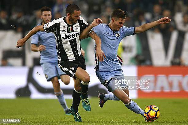 Juventus' defender Leonardo Bonucci fights for the ball with Sampdoria's forward Patrik Schick of Czech Republic during the Italian Serie A football...