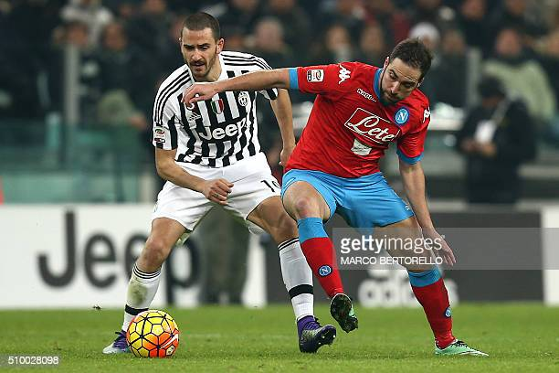 Juventus' defender Leonardo Bonucci fights for the ball with Napoli's forward Gonzalo Higuain during the Italian Serie A football match Juventus vs...