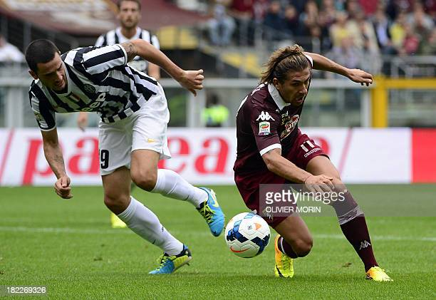 Juventus' defender Leonardo Bonucci fights for the ball with Torino's midfielder Alessio Cerci during the Serie A football match Torino vs Juventus...