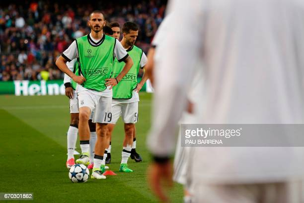 Juventus' defender Leonardo Bonucci looks on as he trains before the UEFA Champions League quarterfinal second leg football match FC Barcelona vs...