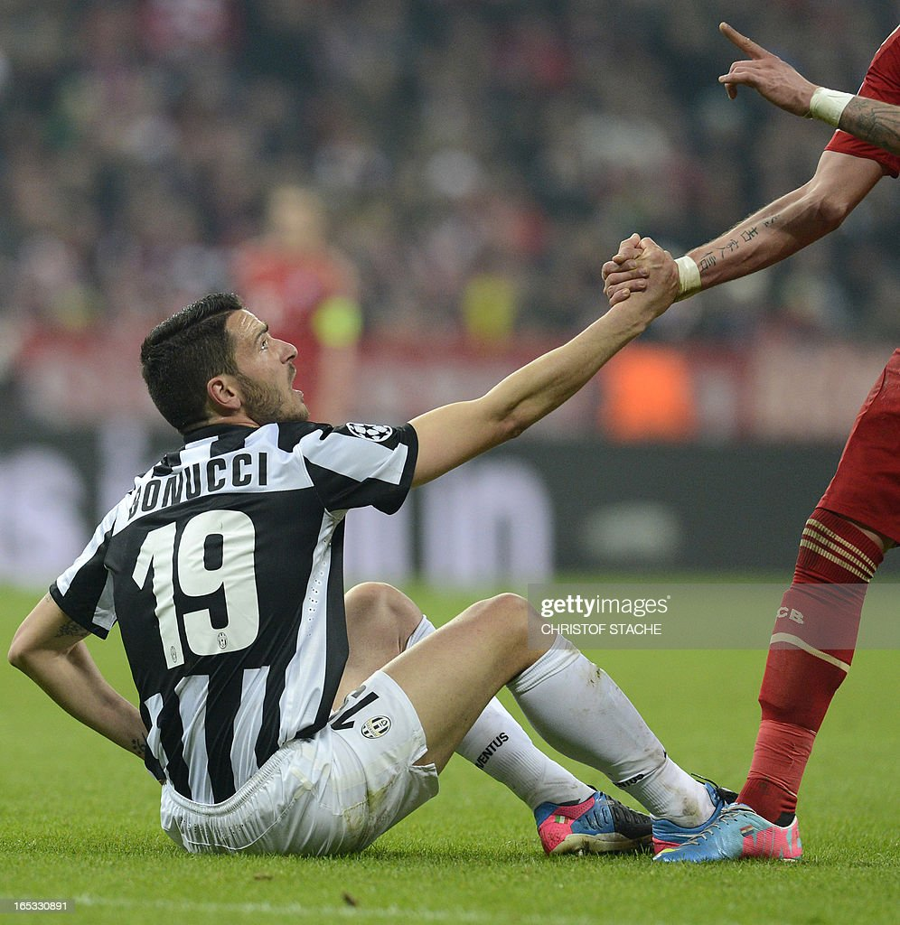 Juventus' defender Leonardo Bonucci sits on the pitch after an attack during the UEFA Champions League quarter final football match FC Bayern Munich vs Juventus Turin in Munich, southern Germany, on April 2, 2013.