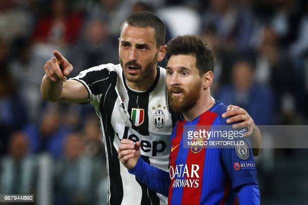 Juventus' defender Leonardo Bonucci speaks to Barcelona's forward Lionel Messi from Argentina during the UEFA Champions League quarter final first...