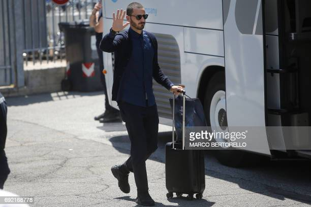 Juventus' defender Leonardo Bonucci waves to fans as players arrive at the Turin Airport on June 4 a day after the UEFA Champions League final...