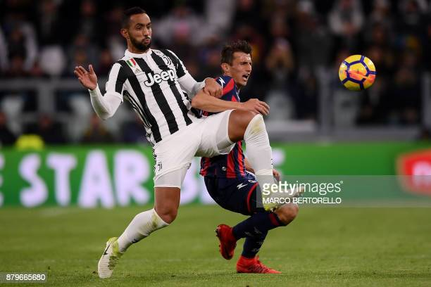 Juventus' defender Medhi Amine Benatia from Morocco fights for the ball with Crotone's forward Alexander Tonev of Bulgaria during the Italian Serie A...