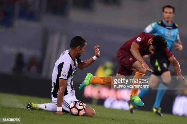 Juventus' defender Medhi Benatia vies with Roma's midfielder from Egypt Mohamed Salah during the Italian Serie A football match Roma vs Juventus on...