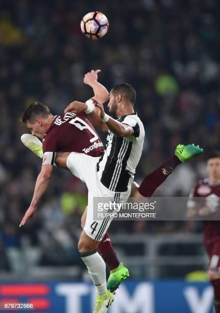 Juventus defender Medhi Benatia vies with Torino's forward Andrea Belotti during the Italian Serie A football match Juventus vs Torino FC at the...