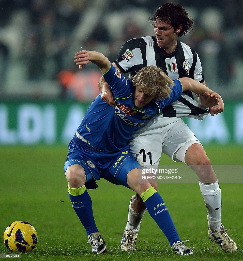 Juventus' defender Paolo De Ceglie (R) vies with Udinese's Serbian defender Dusan Basta during their Serie A football match in Turin's Juventus Stadium on January 19, 2013.