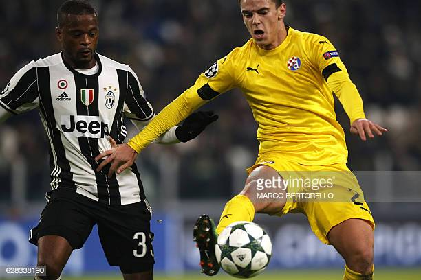Juventus' defender Patrice Evra from France fights for the ball with Dinamo's midfielder El Arabi Hilal Soudani from Algeria during the UEFA...