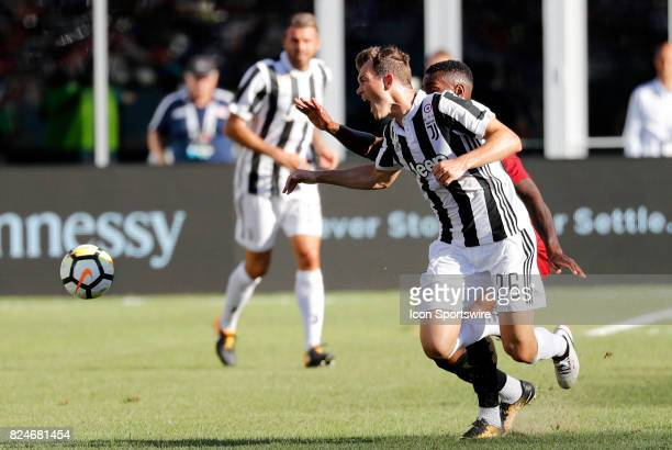 Juventus defender Stephan Lichtsteiner foued by Roma midfielder Gerson during an International Champions Cup match between AS Roma and Juventus on...
