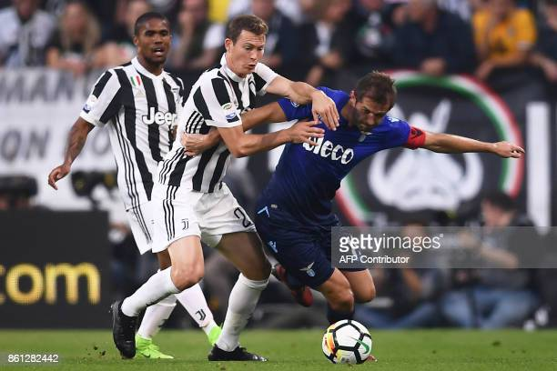Juventus' defender Stephan Lichtsteiner from Switzerland fights for the ball with Lazio's midfielder Senad Lulic of Bosnia during the Italian Serie A...
