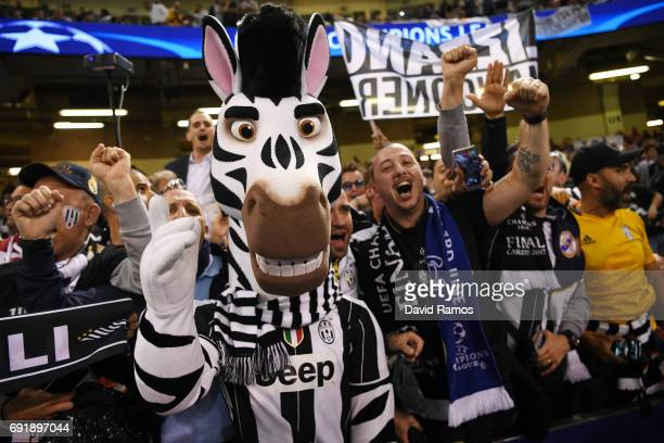 Juventus fan dressed as a Zebra enjoys the pre match atmosphere prior to the UEFA Champions League Final between Juventus and Real Madrid at National...