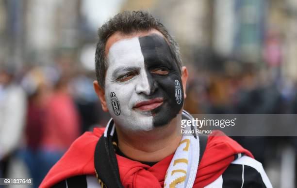 Juventus fan enjoys the city centre atmosphere prior to the UEFA Champions League Final between Juventus and Real Madrid on June 3 2017 in Cardiff...