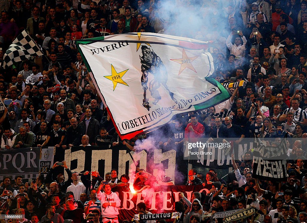 Juventus fan support their team during the Serie A match between S.S. Lazio and Juventus at Stadio Olimpico on April 15, 2013 in Rome, Italy.