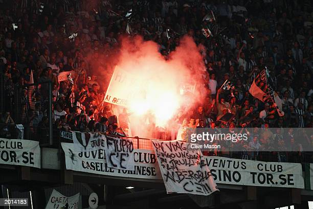 Juventus fans celebrate during the UEFA Champions League semi final second leg match between Juventus and Real Madrid on May 14 2003 at the Stadio...