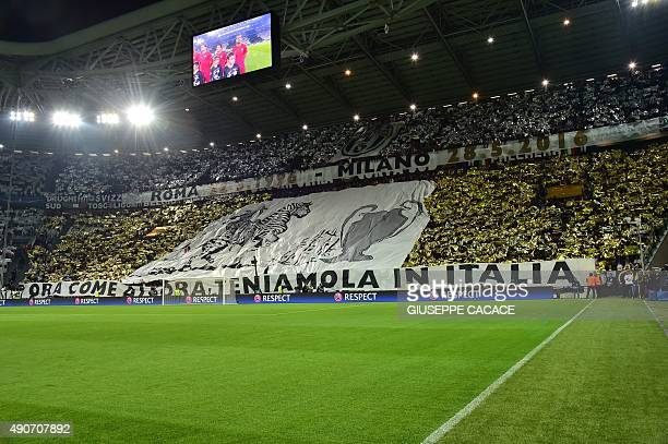 Juventus fans cheer before the UEFA Champions League football match Juventus vs FC Sevilla on September 30 at the Juventus stadium in Turin AFP PHOTO...