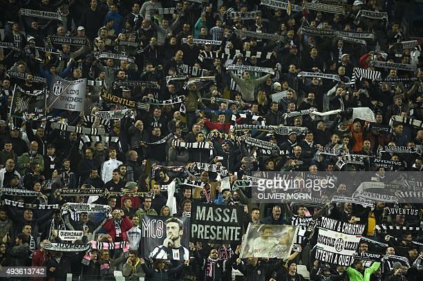 Juventus fans cheer before the UEFA Champions League football match Juventus vs Borussia Monchengladbach on October 21 2015 at the Juventus stadium...