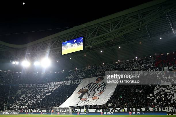 Juventus fans cheer before the UEFA Champions League football match Juventus vs Manchester City on November 25 2015 at the Juventus Stadium in Turin...