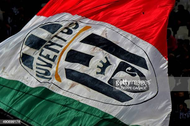 Juventus fans deploy a giant flag in the stands before the start of the UEFA Champions League football match Juventus vs FC Sevilla on September 30...