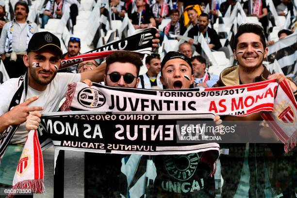 Juventus' fans pose before the UEFA Champions League semi final second leg football match Juventus vs Monaco on May 9 2017 at the Juventus stadium in...