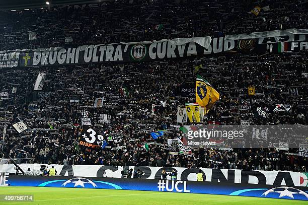 Juventus fans show their support ahead of the UEFA Champions League Group D match between Juventus and Manchester City at the Juventus Stadium on...