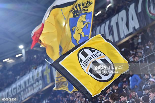 Juventus fans wave flags before the UEFA Champions League football match Juventus vs Olympique Lyonnais on November 2 2016 at the Juventus stadium in...