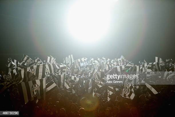 Juventus fans wave flags during the UEFA Champions League Round of 16 between Borussia Dortmund and Juventus at Signal Iduna Park on March 18 2015 in...