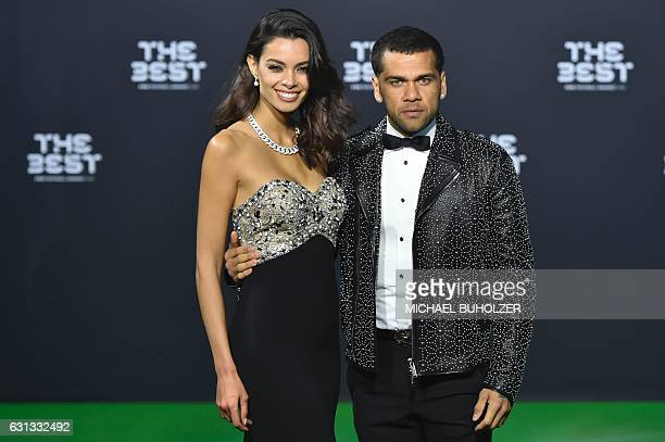 Juventus FC and Brazil's defender Dani Alves and his partner Joana Sanz pose as they arrive for The Best FIFA Football Awards 2016 ceremony on...