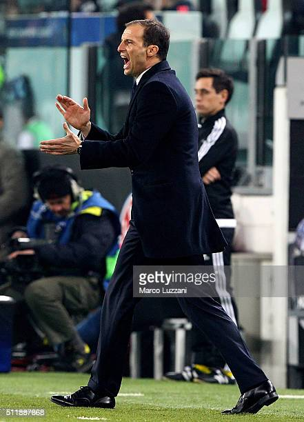 Juventus FC coach Massimiliano Allegri shouts to his players during the UEFA Champions League Round of 16 first leg match between Juventus and FC...
