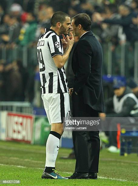 Juventus FC coach Massimiliano Allegri speaks to his player Leonardo Bonucci during the UEFA Champions League Round of 16 match between Juventus and...