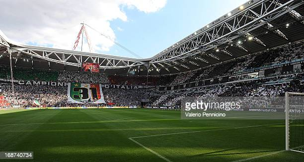 Juventus FC fans display a giant banner prior to the Serie A match between Juventus and Cagliari Calcio at Juventus Arena on May 11 2013 in Turin...