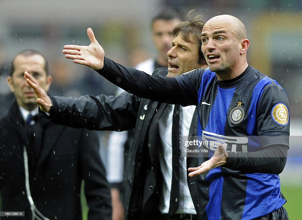 Juventus FC head coach Antonio Conte and Esteban Cambiasso of FC Inter Milan (R) react during the Serie A match between FC Internazionale Milano and Juventus FC at San Siro Stadium on March 30, 2013 in Milan, Italy.