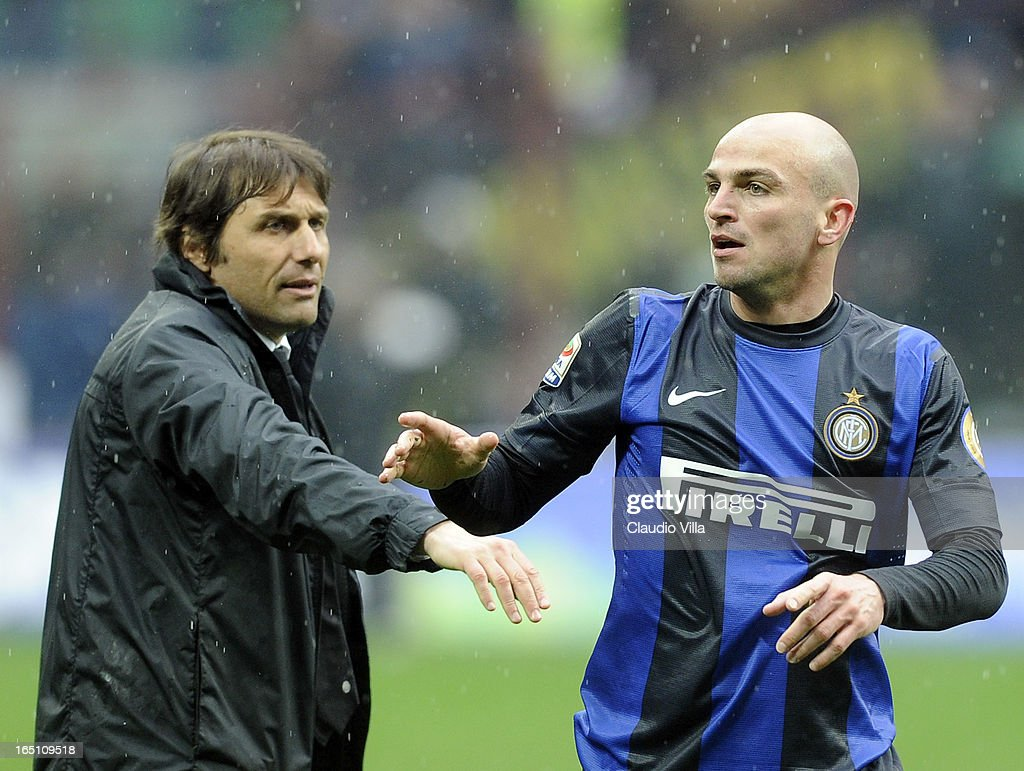 Juventus FC head coach Antonio Conte and Esteban Cambiasso of FC Inter Milan (R) during the Serie A match between FC Internazionale Milano and Juventus FC at San Siro Stadium on March 30, 2013 in Milan, Italy.