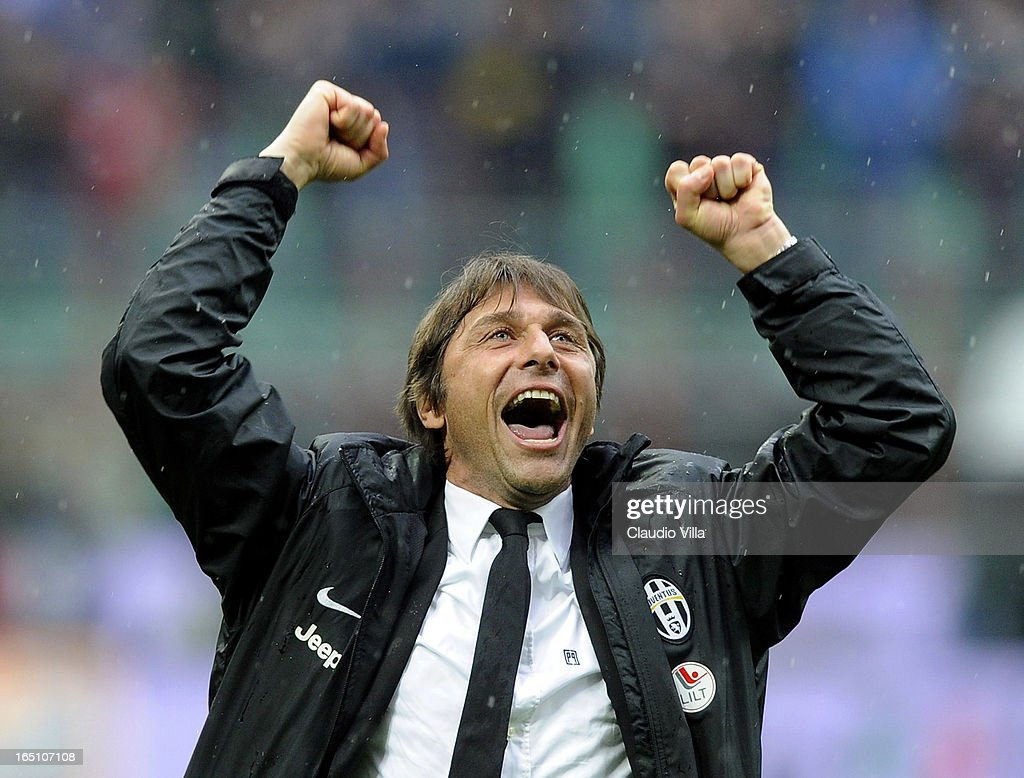 Juventus FC head coach Antonio Conte celebrates victory at the end of the Serie A match between FC Internazionale Milano and Juventus FC at San Siro Stadium on March 30, 2013 in Milan, Italy.