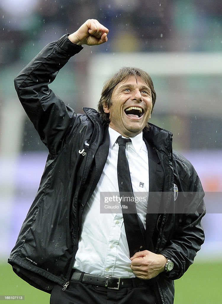 Juventus FC head coach <a gi-track='captionPersonalityLinkClicked' href=/galleries/search?phrase=Antonio+Conte&family=editorial&specificpeople=2379002 ng-click='$event.stopPropagation()'>Antonio Conte</a> celebrates victory at the end of the Serie A match between FC Internazionale Milano and Juventus FC at San Siro Stadium on March 30, 2013 in Milan, Italy.