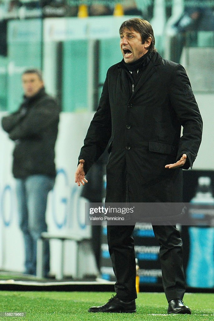 Juventus FC head coach <a gi-track='captionPersonalityLinkClicked' href=/galleries/search?phrase=Antonio+Conte&family=editorial&specificpeople=2379002 ng-click='$event.stopPropagation()'>Antonio Conte</a> reacts during the TIM Cup match between Juventus FC and Cagliari Calcio at Juventus Arena on December 12, 2012 in Turin, Italy.