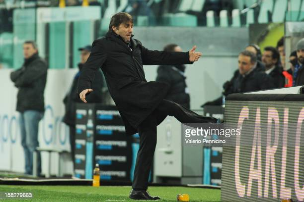 Juventus FC head coach Antonio Conte reacts during the TIM Cup match between Juventus FC and Cagliari Calcio at Juventus Arena on December 12 2012 in...