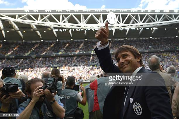 Juventus FC head coach Antonio Conte salutes during the Serie A match between Juventus and Cagliari Calcio at Juventus Arena on May 18 2014 in Turin...