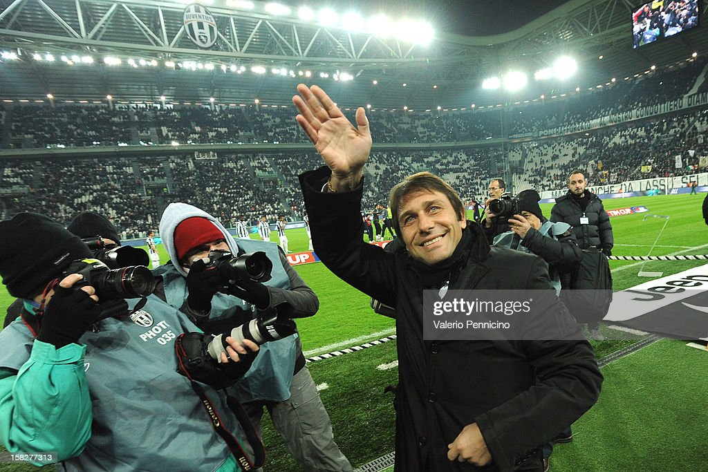 Juventus FC head coach <a gi-track='captionPersonalityLinkClicked' href=/galleries/search?phrase=Antonio+Conte&family=editorial&specificpeople=2379002 ng-click='$event.stopPropagation()'>Antonio Conte</a> salutes prior to the TIM Cup match between Juventus FC and Cagliari Calcio at Juventus Arena on December 12, 2012 in Turin, Italy.