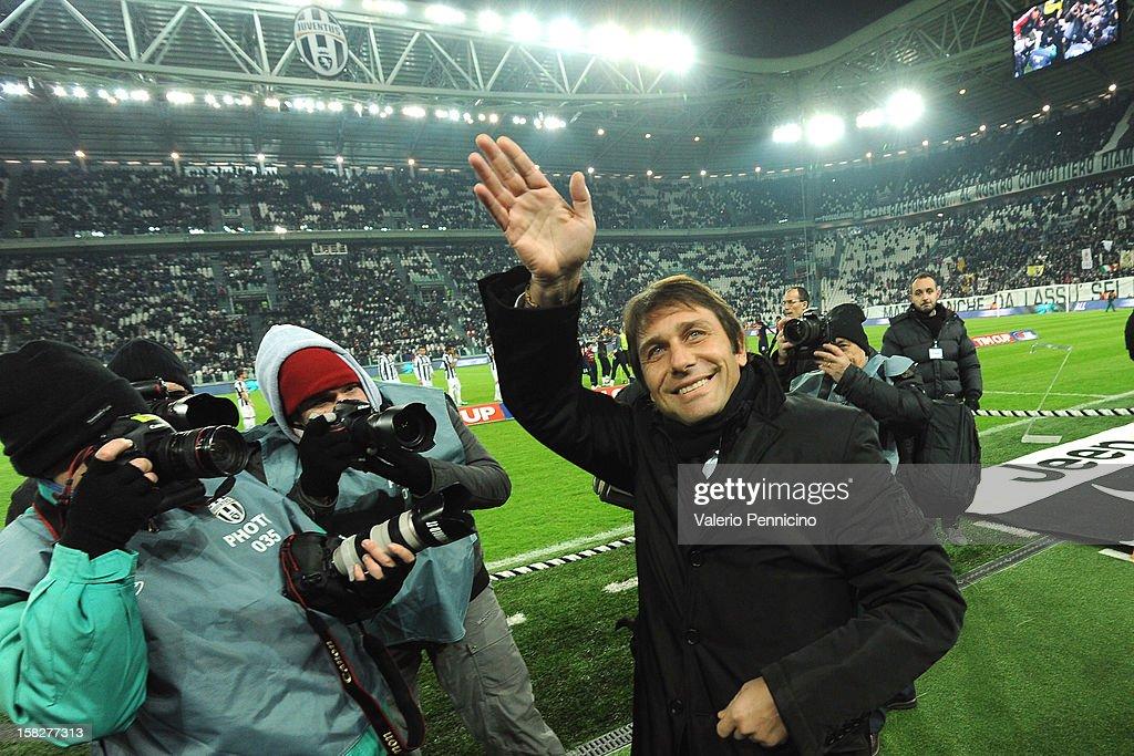 Juventus FC head coach Antonio Conte salutes prior to the TIM Cup match between Juventus FC and Cagliari Calcio at Juventus Arena on December 12, 2012 in Turin, Italy.